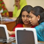 Social and Financial Empowerment of Adolescents (SoFEA) participants learn computer and IT skills. SoFEA clubs like this one provide adolescent girls with the skills and knowledge needed to empower themselves.
