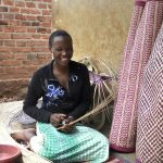 Brenda Masika weaves and sells mats and baskets, skills she learned at an Empowerment and Livelihoods for Adolescents (ELA) club in Uganda.