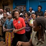 Members of an Empowerment and Livelihoods for Adolescents (ELA) club in Uganda sing during a meeting.